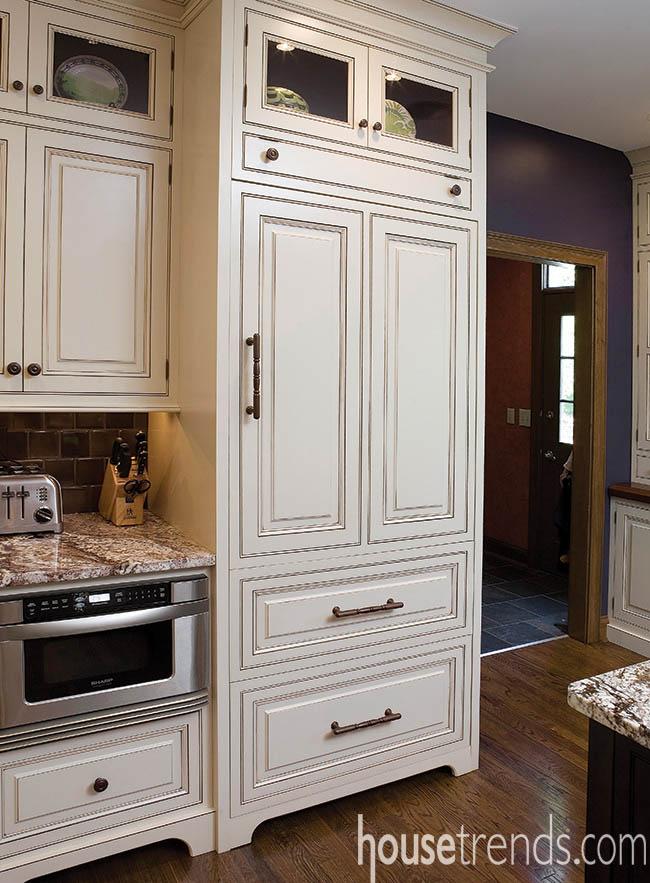 Custom panels hide a refrigerator