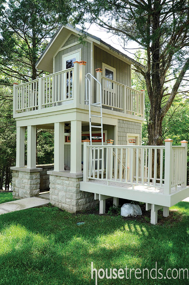 Playhouse deck design inspired by the style of the main house