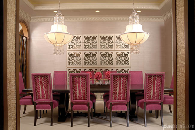 Dining room design ideas include fuchsia chairs