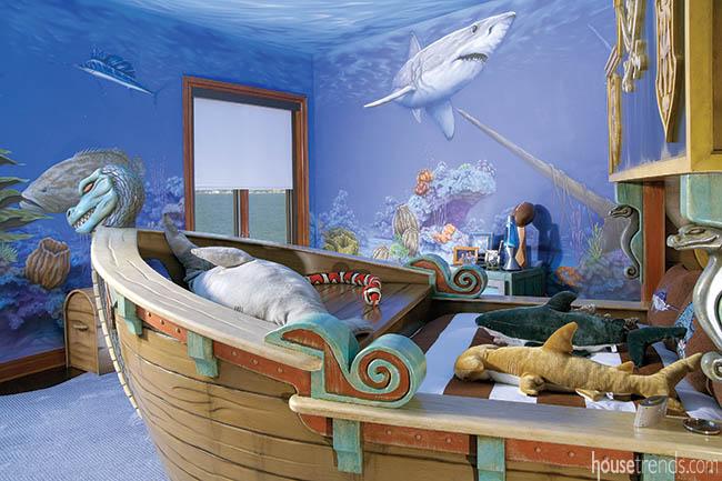 Kids bedroom features an ocean-themed wall mural