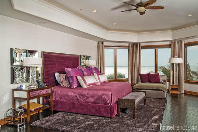 Fuchsia bedding pops in a master bedroom