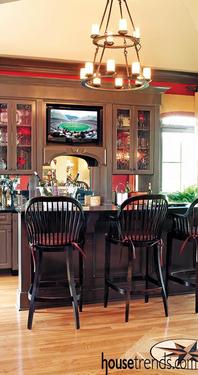 Chandelier lends interest to a bar design