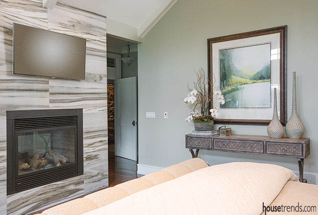 Fireplace warms up a bedroom design