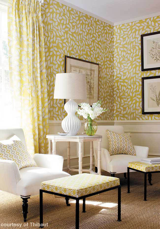 Yellow decor complements classic white molding
