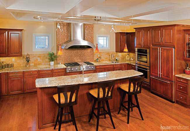 Oak flooring complements cherry cabinetry