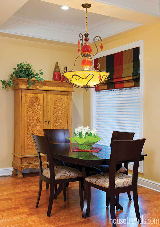 Colorful chandelier dangles over a kitchen table