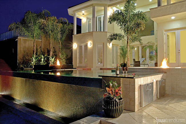 Outdoor lighting adds drama to a back yard