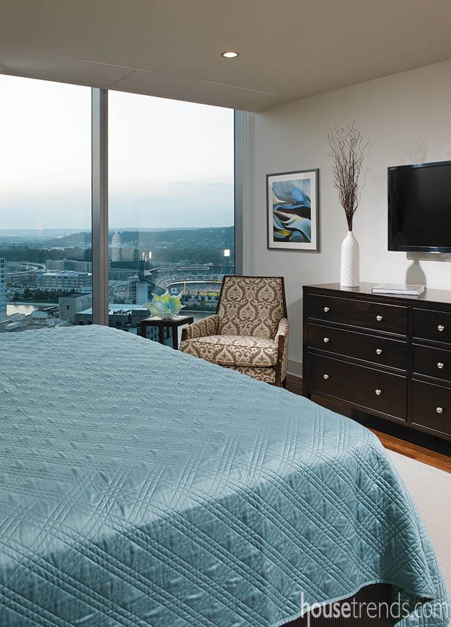 Floor-to-ceiling windows in a master bedroom