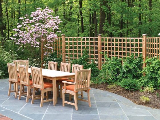 Garden fencing encloses outdoor dining area