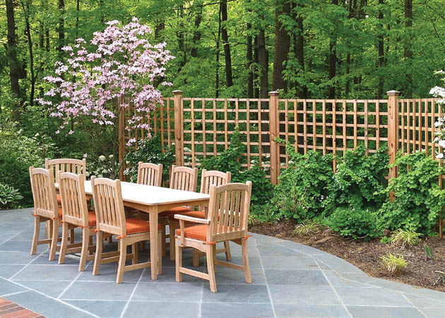 Garden fencing encloses outdoor dining area
