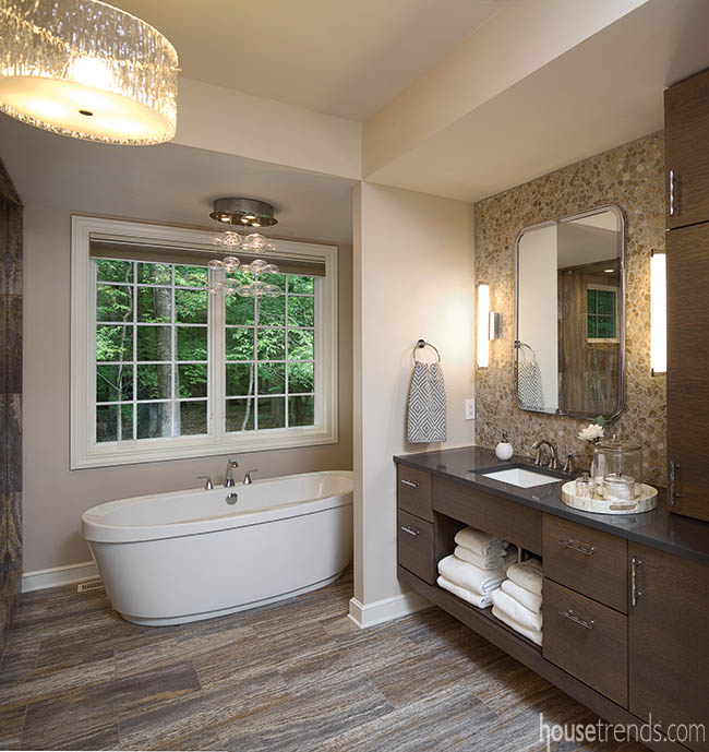 Light fixture adds glamor to a master bath