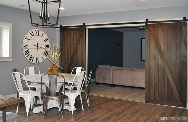 Sliding barn doors add privacy to a home theater
