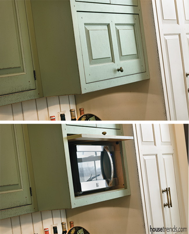 Microwave gets tucked inside of a cabinet