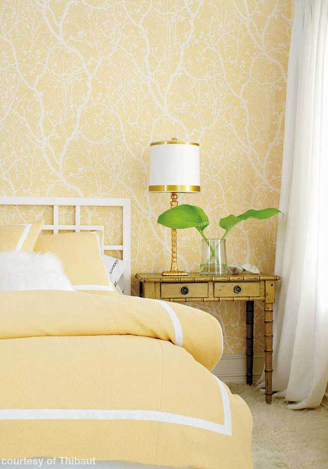 Yellow wallpaper in a guest room