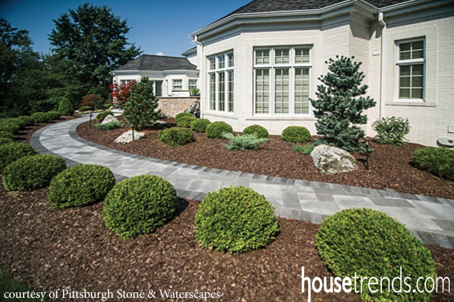 Landscape design with low maintenance plants on rock bed around house, soil erosion around house, palm trees around house, gutters around house, small trees around house, chain link fence around house, flower bed between sidewalk and house, dog fence around house, flagstone around house, drain pipe around house, railroad ties around house, cedar fence around house, building around house, security fence around house, good plants for front of house, boulders around house, storage around house, framing around house, utility landscape around house, sidewalks around house,