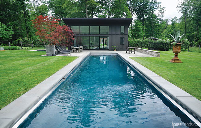 Lap pool boasts a motorized cover