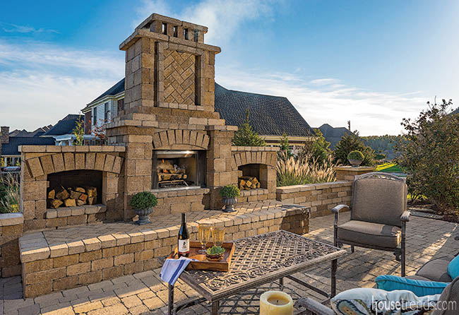 Outdoor fireplace dominates a back yard patio
