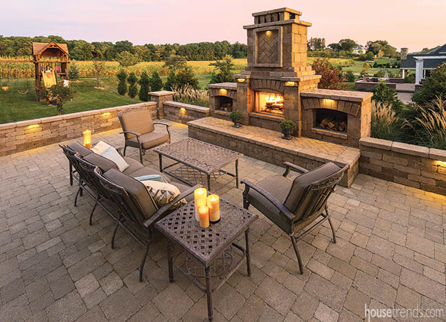 Fireplace adds privacy to an outdoor living space