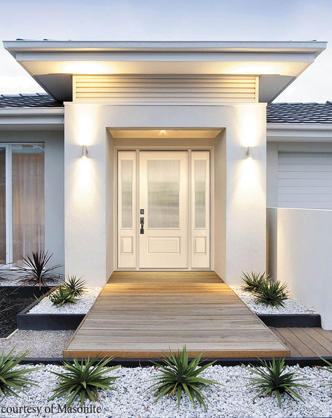 Etched glass lends privacy to entry doors