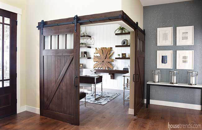 Barn doors lend privacy to a corner study