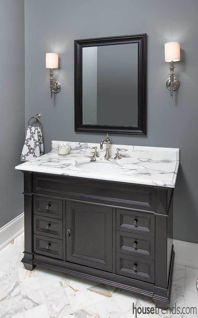 Formal half bath plays with neutrals