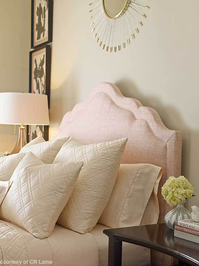 Bedroom with an upholstered headboard