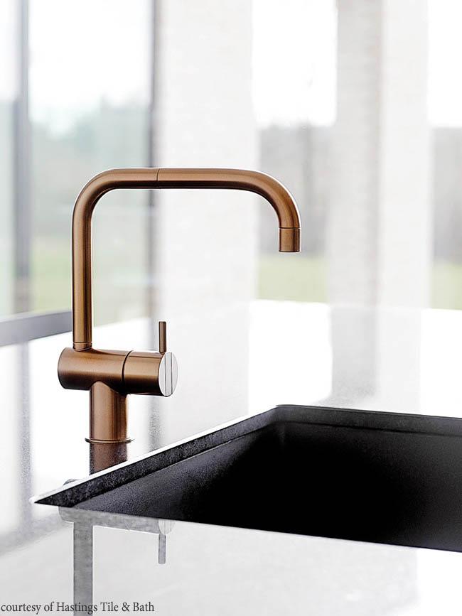 Sleek kitchen faucet complements a kitchen