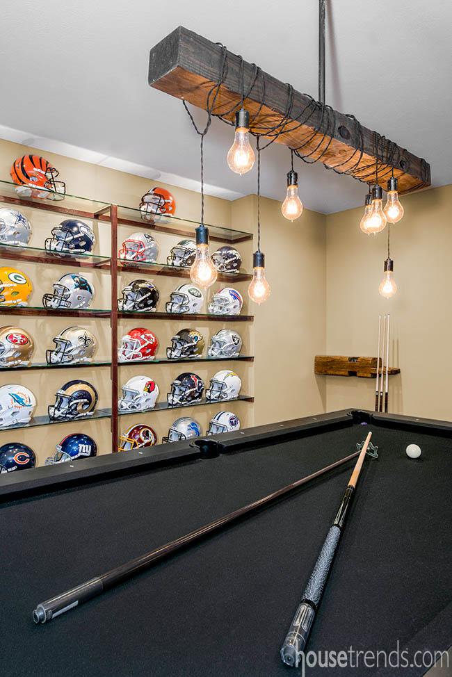 Football helmets on display in a basement