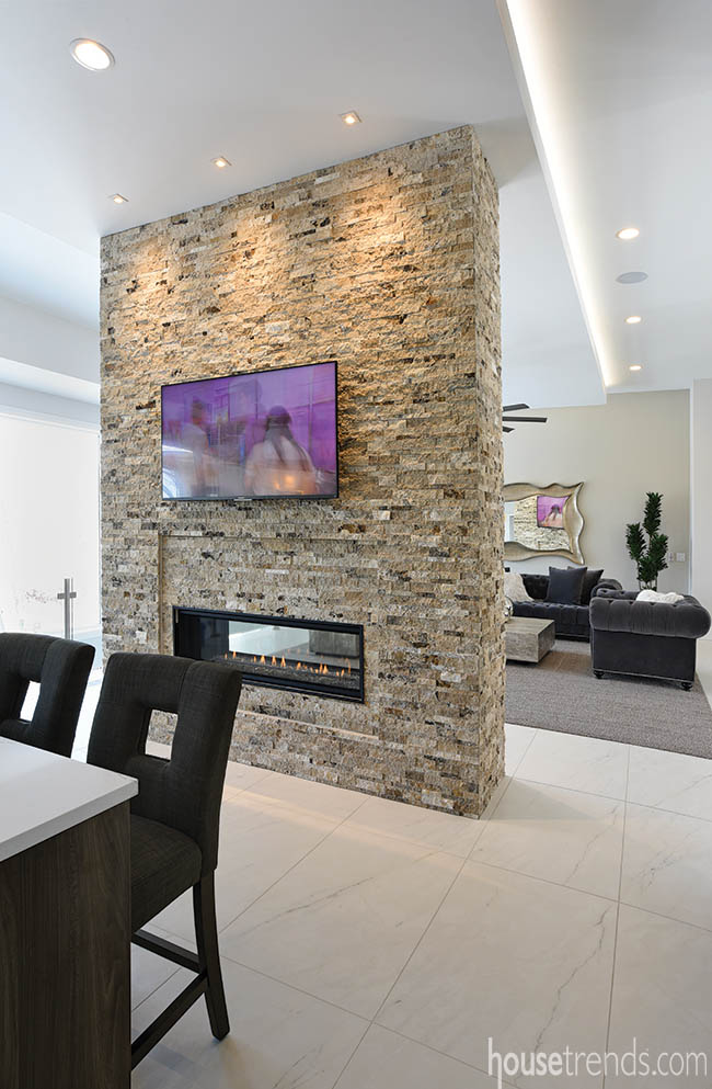 Two-sided fireplace gives the illusion of privacy