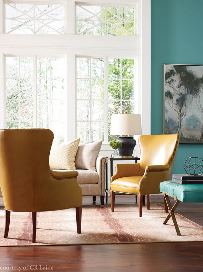 Nailhead trim accents wingback chairs