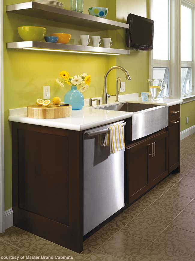 Cheery yellow paint contrasts with dark cabinetry