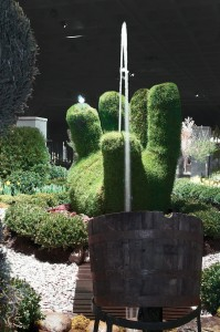 Large topiary hand with water feature