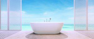 Bathroom in front of beach and ocean