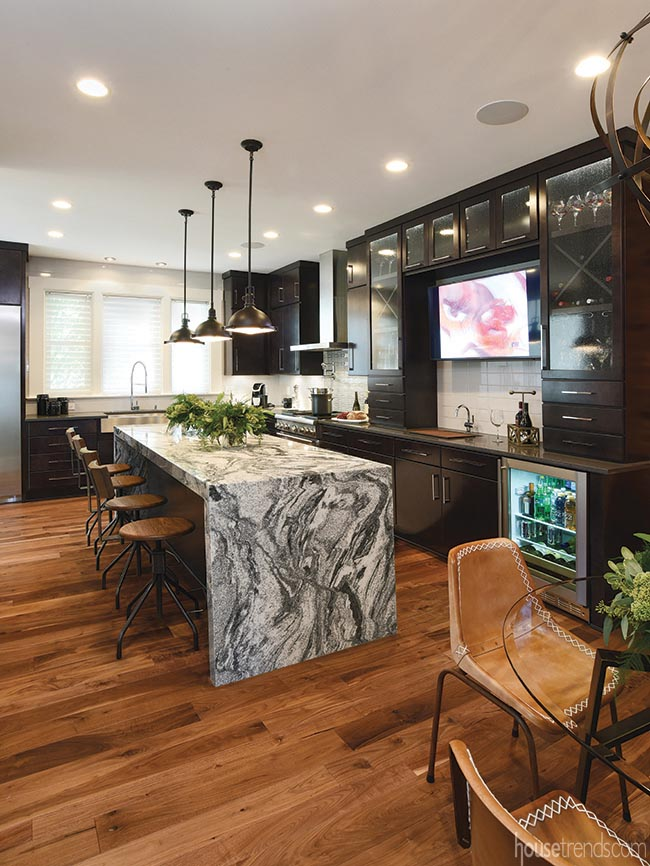 Granite waterfall island dominates a kitchen