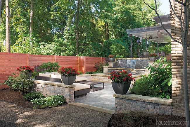Unilock pavers cover a back yard patio